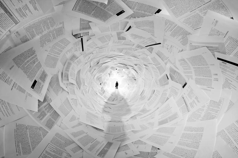 Businessman in the end of documents tunnel. Silhouette of businessman in the end of documents tunnel royalty free stock photography