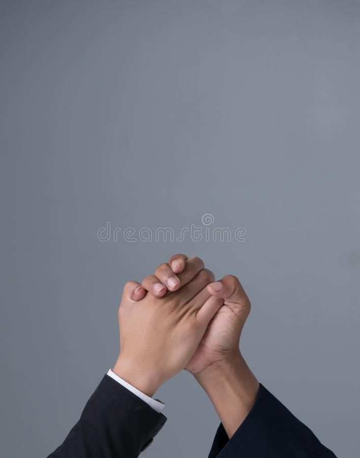 Businessman engaged in arm wrestling. On gray background with copy space stock images
