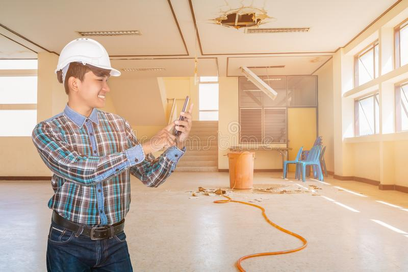 Businessman engineer command with cell phone with 5g network, high-speed mobile Internet. in employment repair water leak drop stock photography