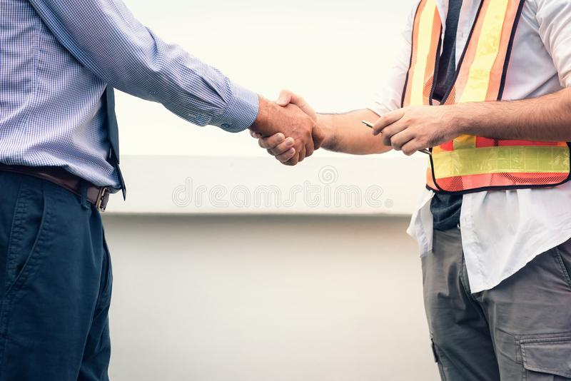 Businessman and engineer handshake after deal successfully at co stock image