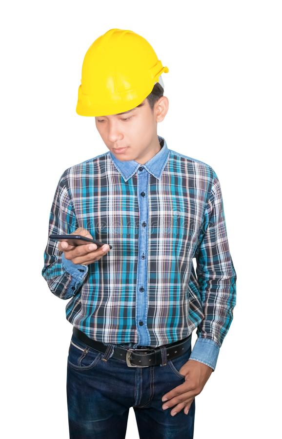 Businessman engineer talk command with cell phone with a 5g network, high-speed mobile Internet. and hold yellow safety helmet royalty free stock photo