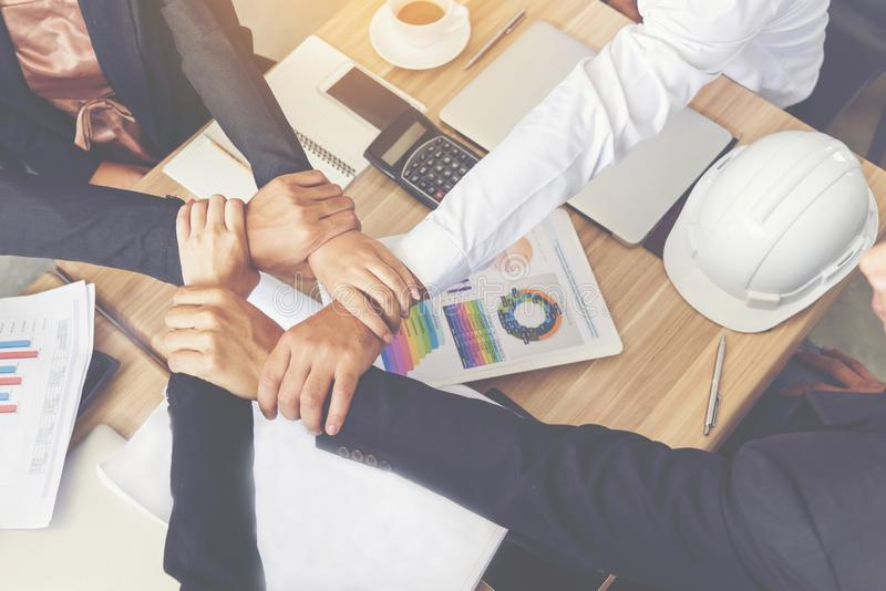 Businessman and engineer working  hands of business people join hand together royalty free stock photo