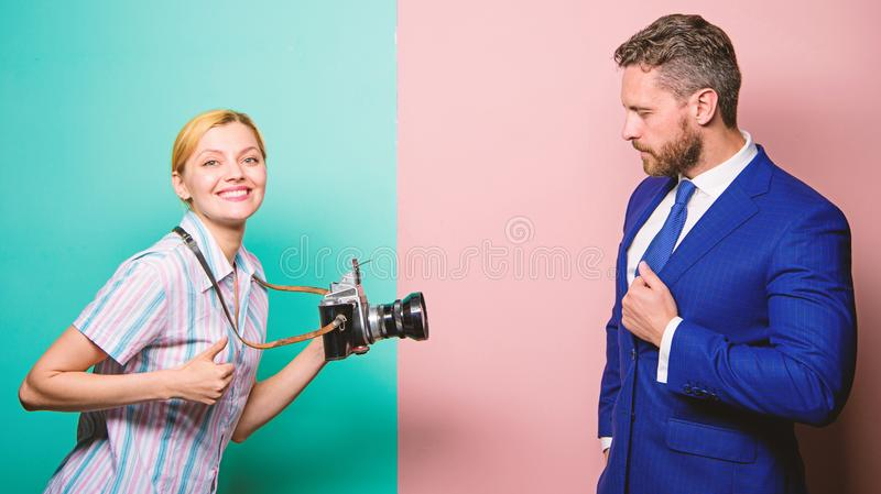 Businessman enjoy star moment. Photographer taking photo successful businessman. Paparazzi concept. Photosession for royalty free stock photography