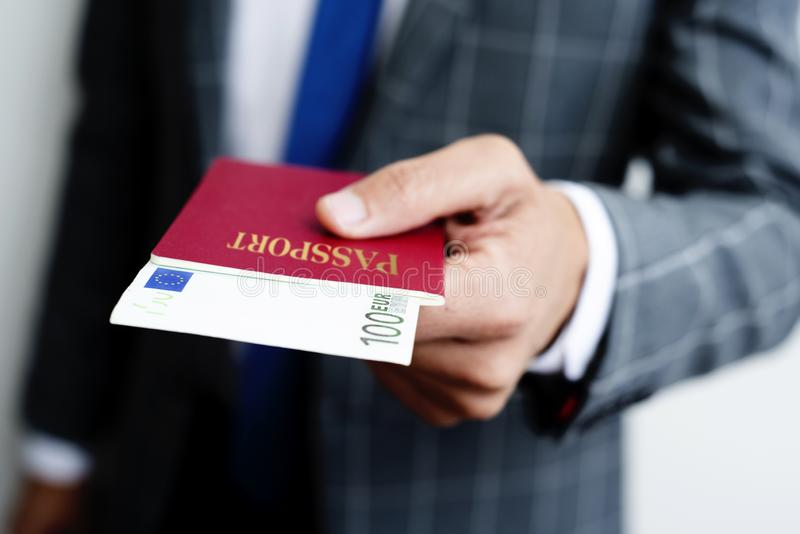 Businessman with 100 euros in his passport royalty free stock image