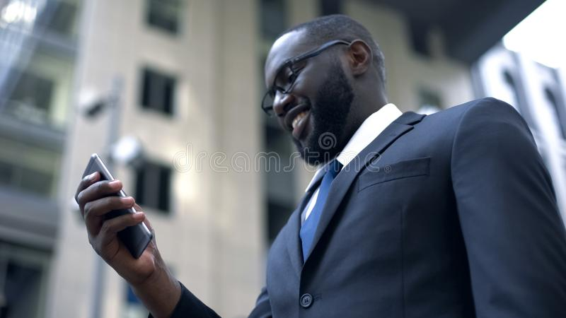 Businessman excited with convenient app in smartphone, electronic organizer. Stock photo stock image