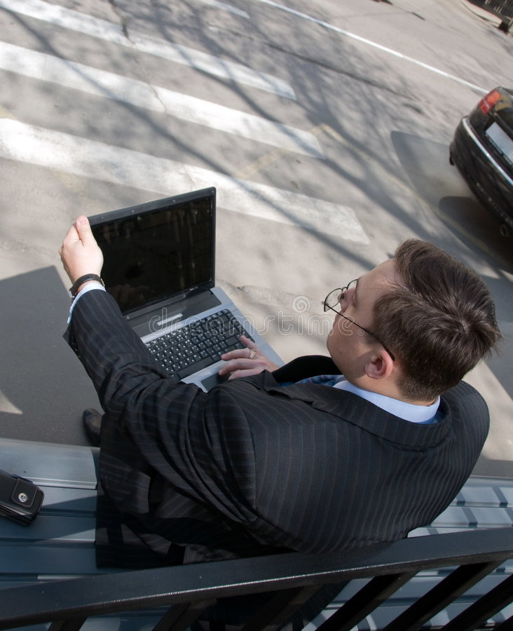 The businessman in expectation of transport royalty free stock photography