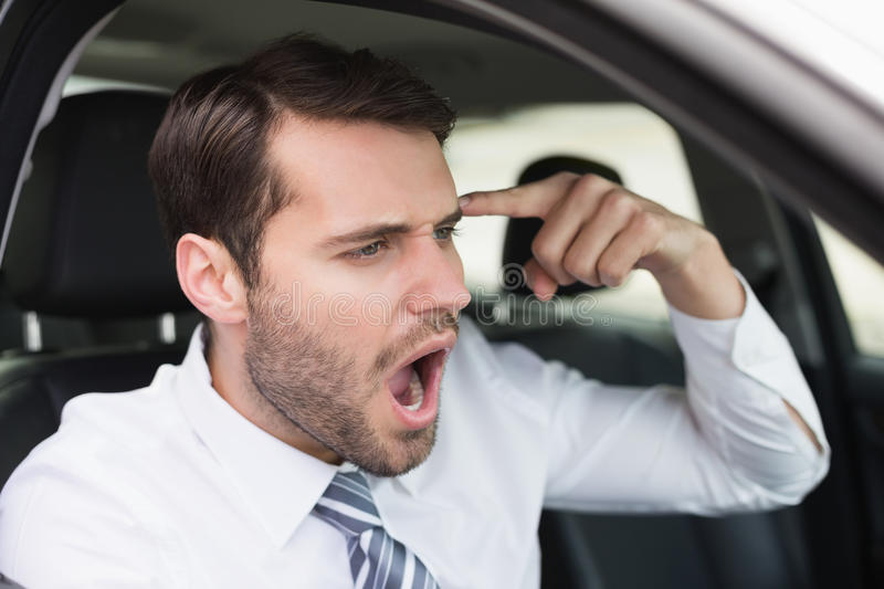 Businessman experiencing road rage. In his car stock images