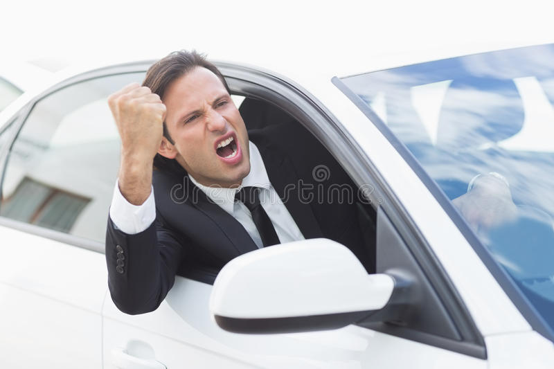 Businessman experiencing road rage. In his car royalty free stock images