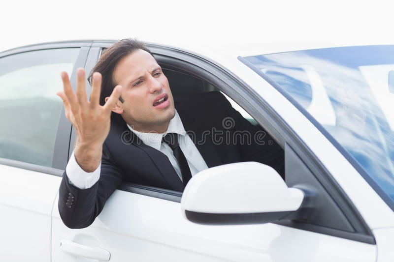 Businessman experiencing road rage. In his car royalty free stock photography