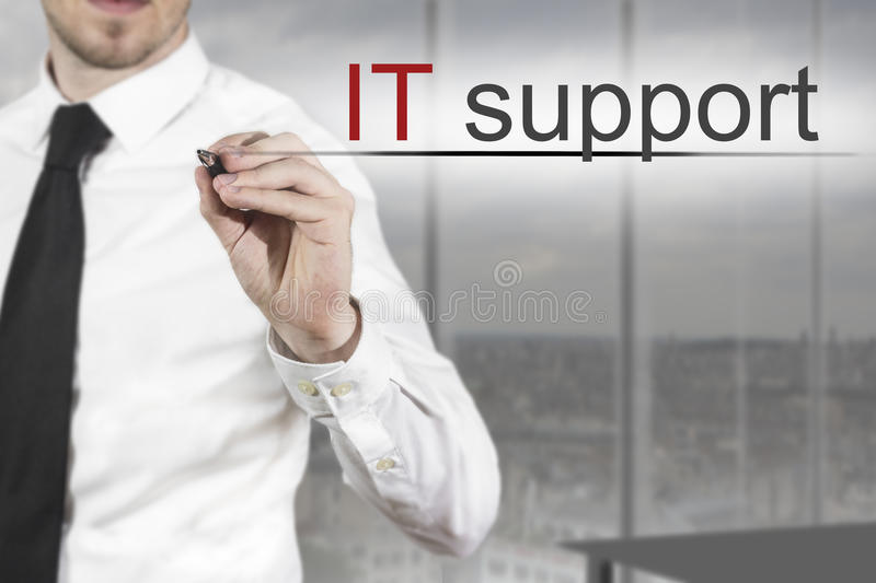 Businessman expert writing it support in the air stock photos