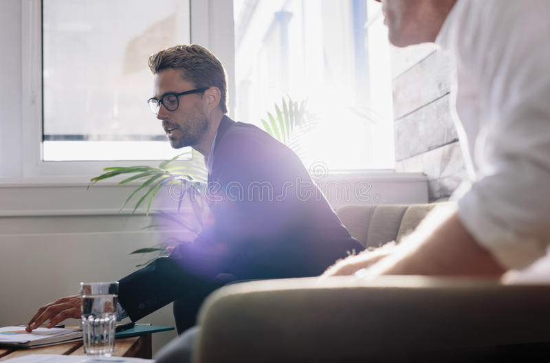 Businessman explaining business plan to colleagues royalty free stock photography