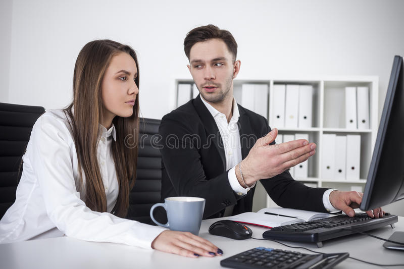 Businessman explaining stuff to his colleague stock photography