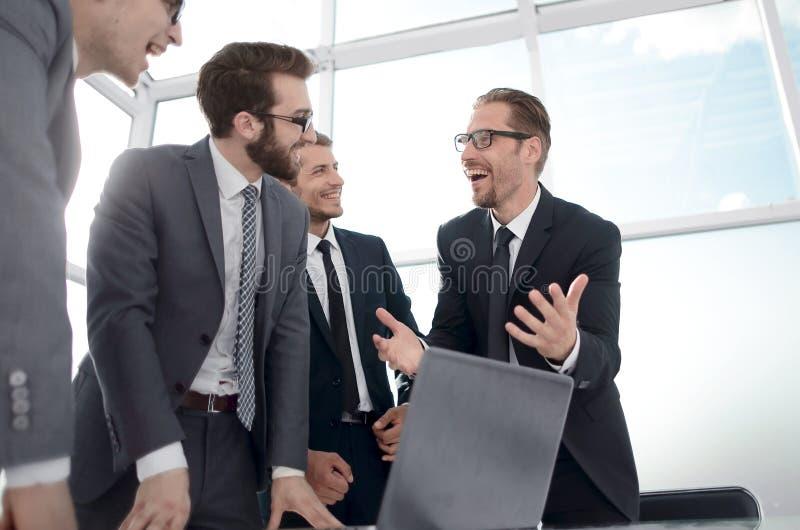 Businessman explaining to employees his new ideas. stock image