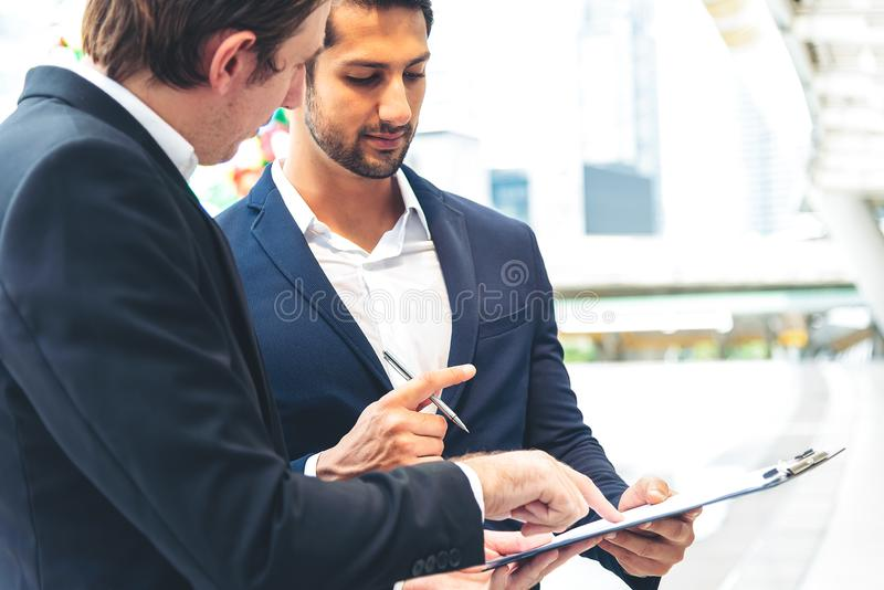 Businessman explaning the contract detail and waiting partner to sign the document outdoor royalty free stock image