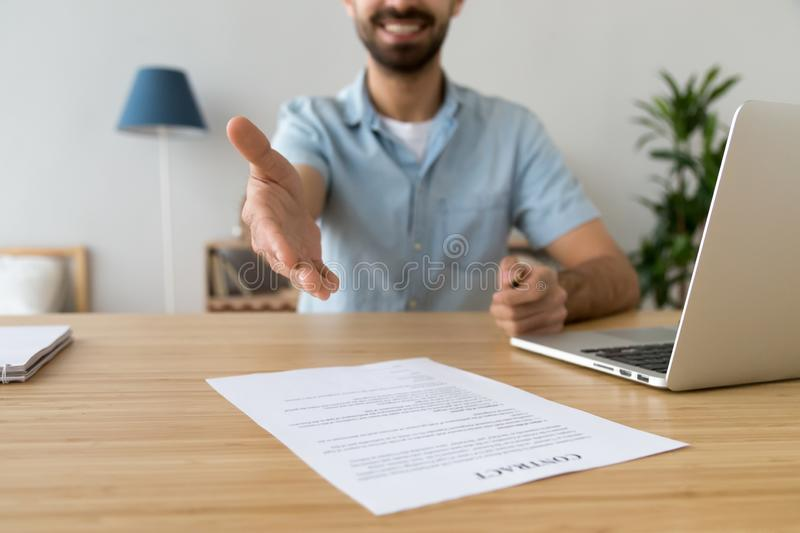 Businessman extending hand for handshake, offer to sign contract royalty free stock images