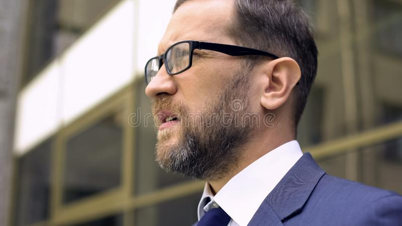 Businessman in eyeglasses close up, worried about business problems, work royalty free stock photos