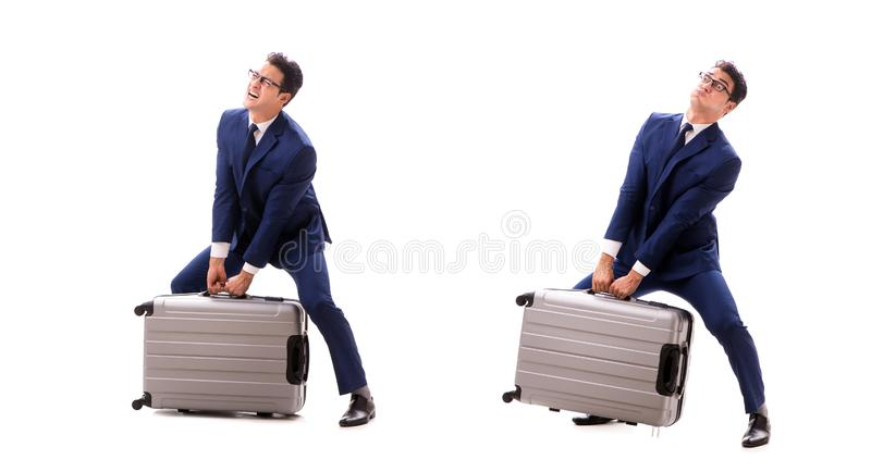The businessman facing excess charges due to heavy suitcase. Businessman facing excess charges due to heavy suitcase stock photography