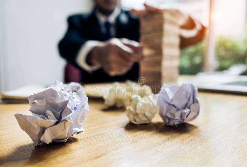 Businessman fail danger tower challenge game. Building consturction protect plan and project for control risk shape with paperwork stock photos