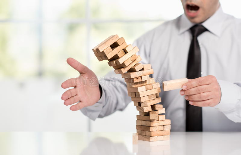 Businessman Fails Building Tower, Business Concept. Businessman Fails Building Tower, Concept For Challenge And Fail In Business stock image