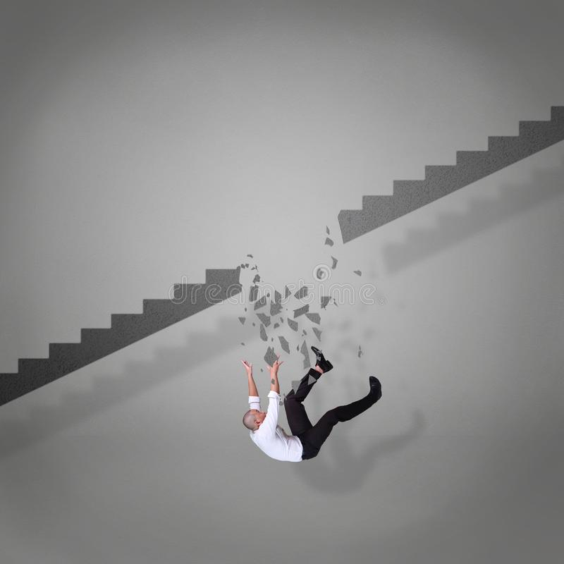 Businessman Falling Down From Broken Stairs stock photos