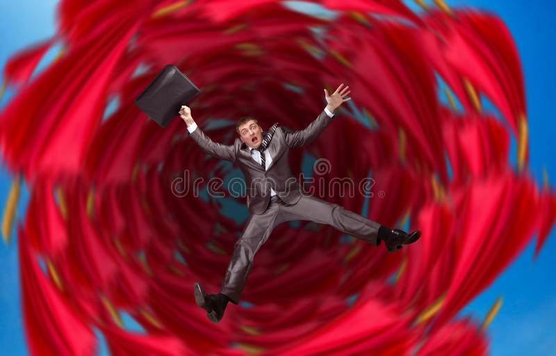 Businessman falls into abyss stock photos