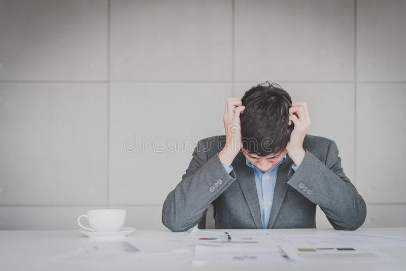 Businessman feeling headache and stress stock image