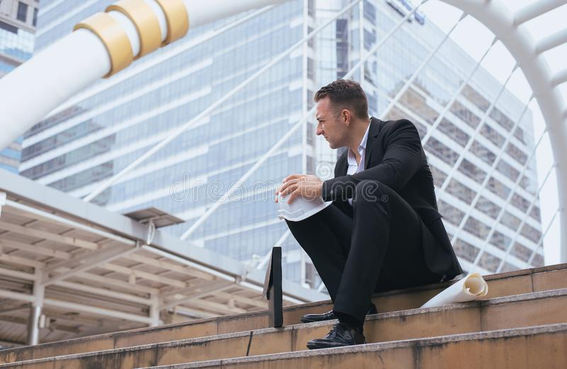 Businessman feeling stressed and tired frustrated failure exhausted in the city,Sitting and thinking stock photo