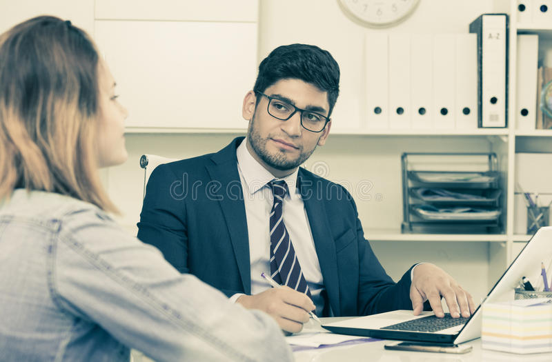 Businessman with female client royalty free stock photo
