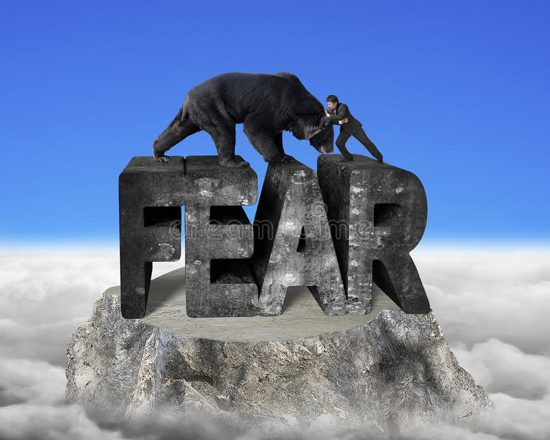 Businessman fighting against black bear on fear 3d concrete word. Businessman fighting against black bear on fear 3d mottled concrete word, on top of mountain stock photography