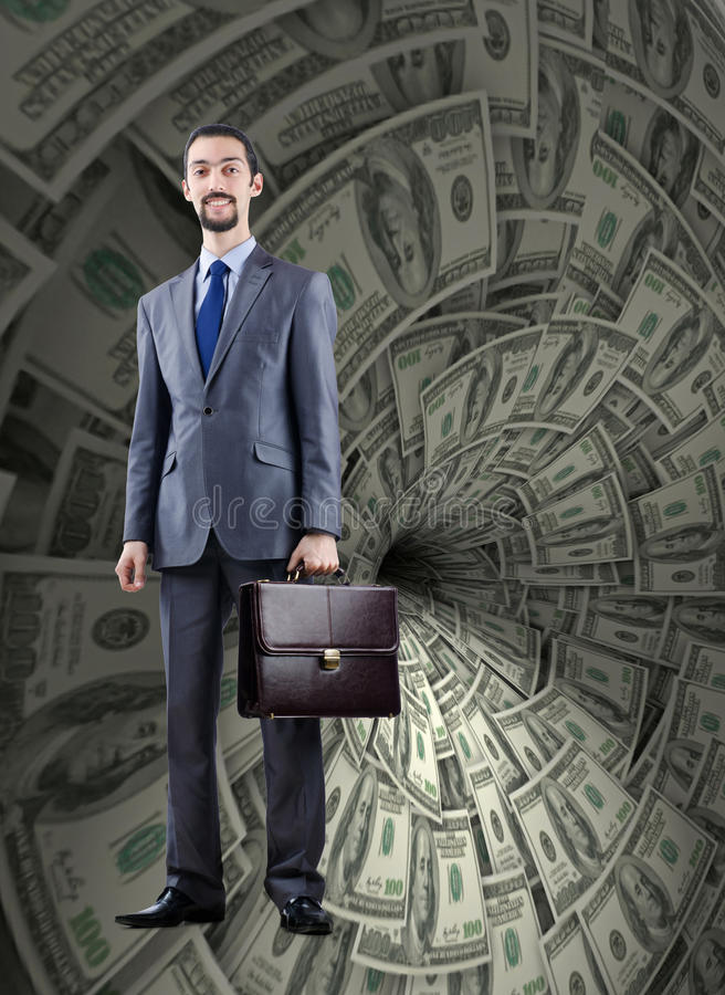 The businessman fighting against dollar funnel. Businessman fighting against dollar funnel stock photo