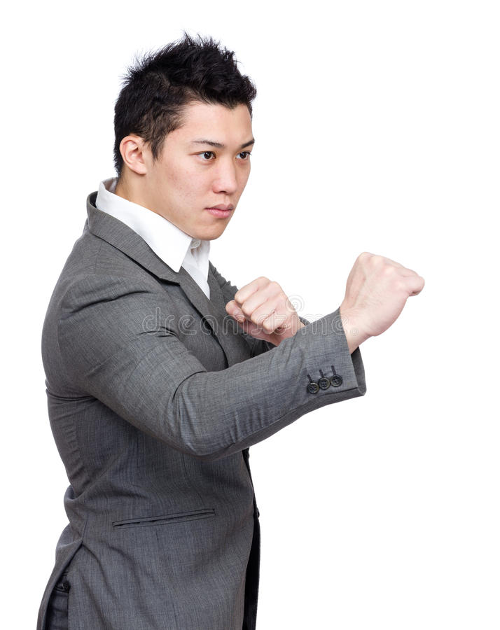 Businessman fighting stock images