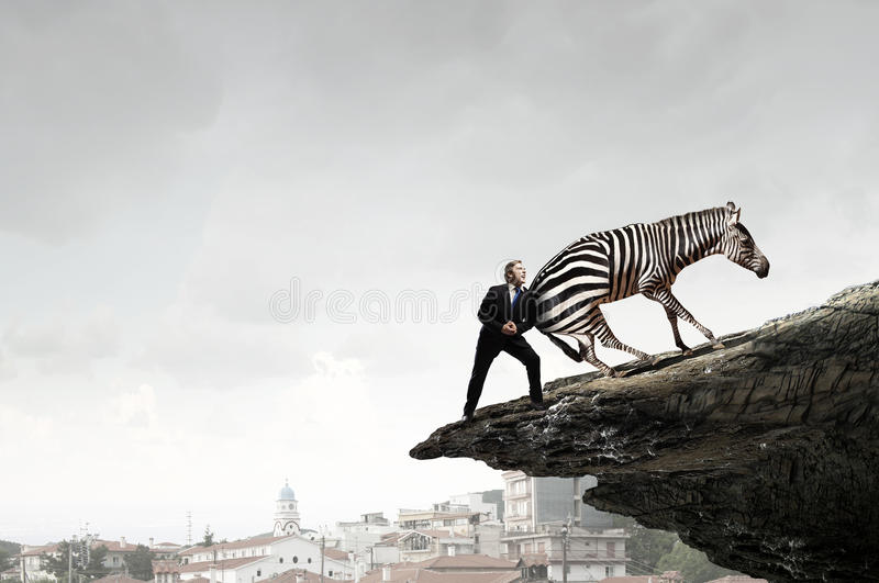 Businessman fighting opponent . Mixed media stock photography