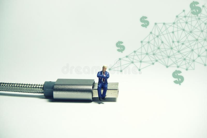 Businessman figure sitting on usb USB cable. E commerce concept.  royalty free illustration