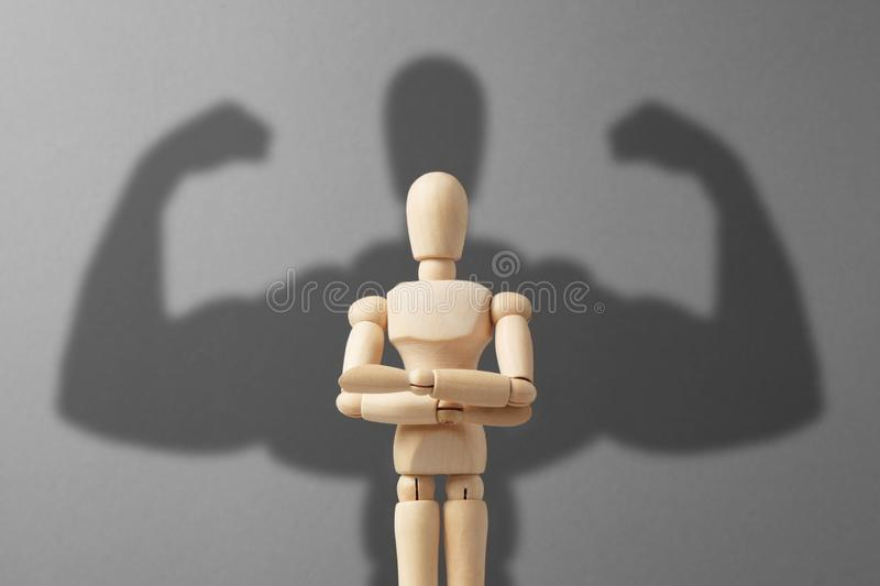 Businessman figure with strong shadow. Concept of power in business stock image