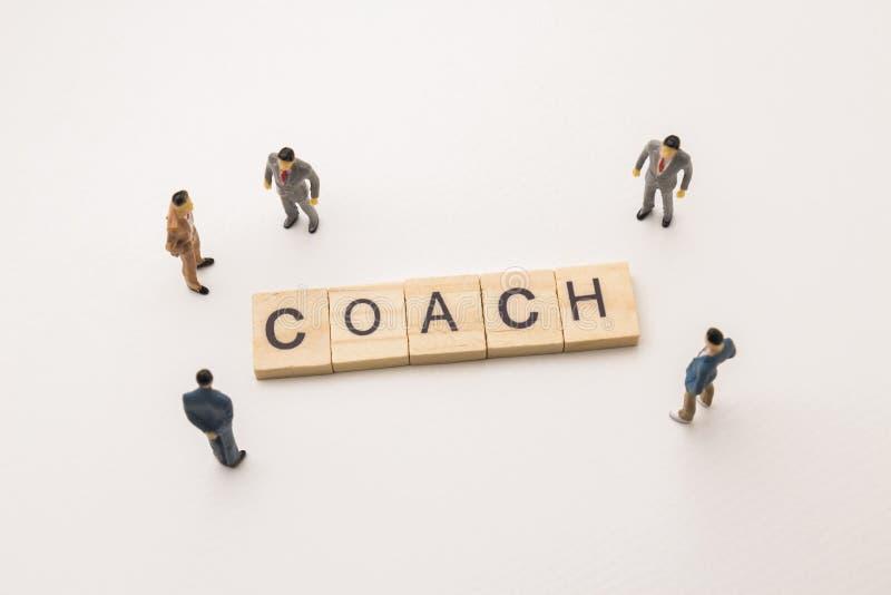Businessman figures meeting on coach conceptual stock photo