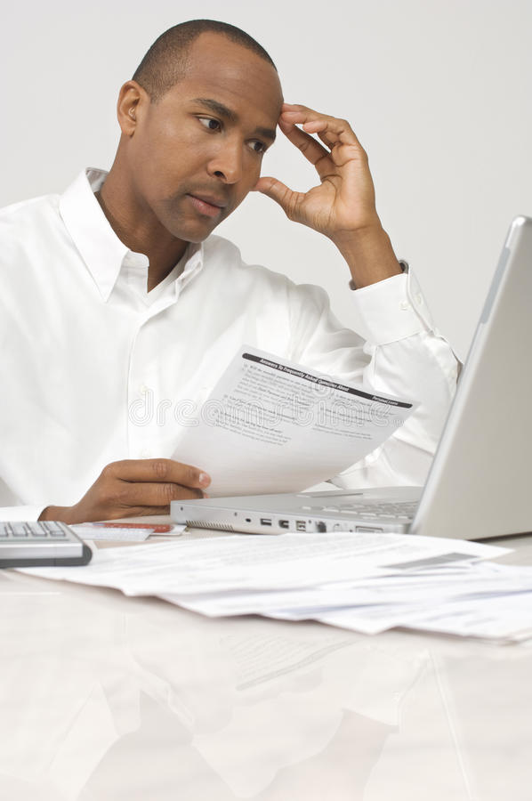 Businessman Figuring Out Bills. Stressed businessman figuring out bills stock images