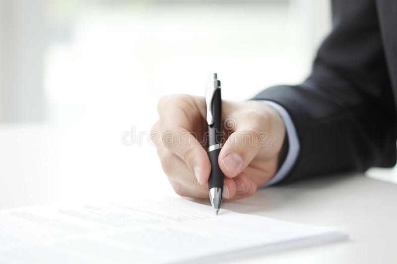 Businessman fill the form. Close-up of businessman fill the form stock image