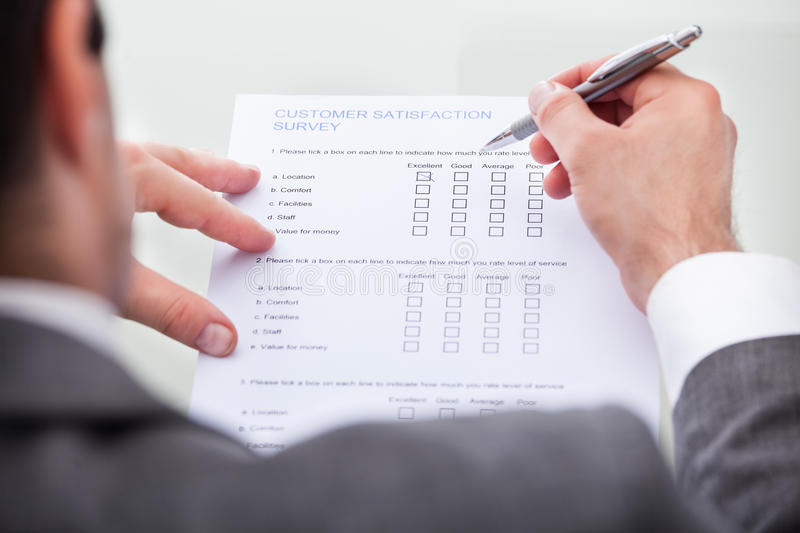 Businessman filling customer survey form royalty free stock photos