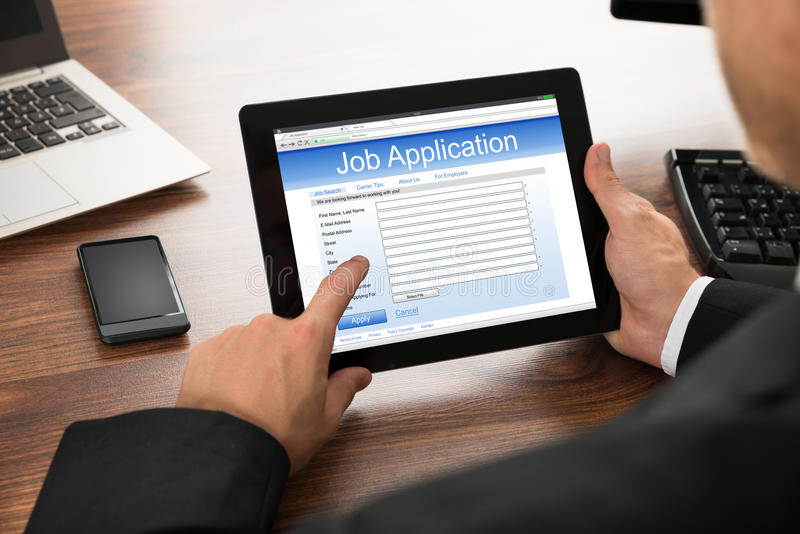 businessman filling online job application stock photo image 54643045. Black Bedroom Furniture Sets. Home Design Ideas