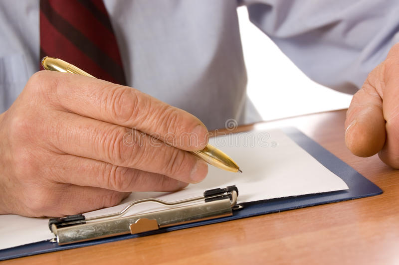 The businessman fills the document. Close up royalty free stock photo
