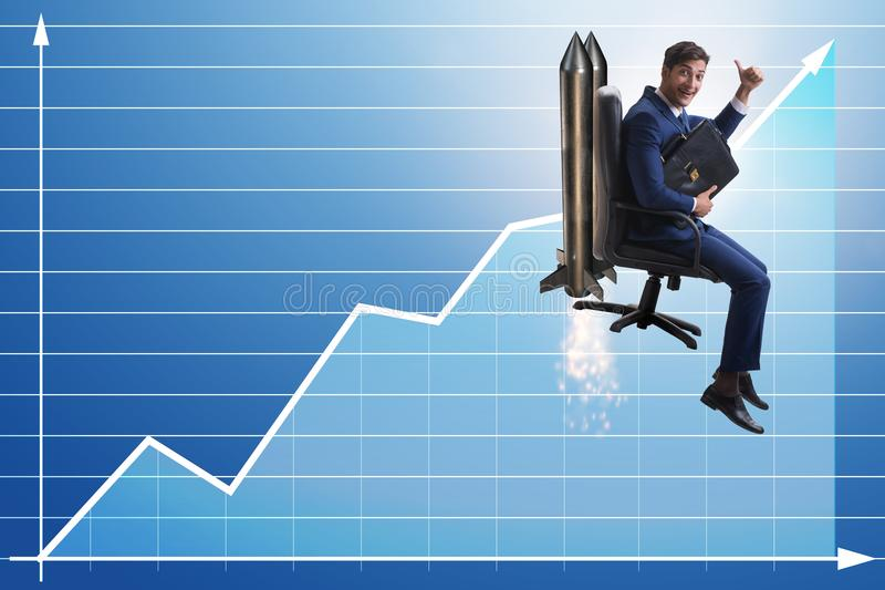 The businessman in financial growth concept. Businessman in financial growth concept stock photo