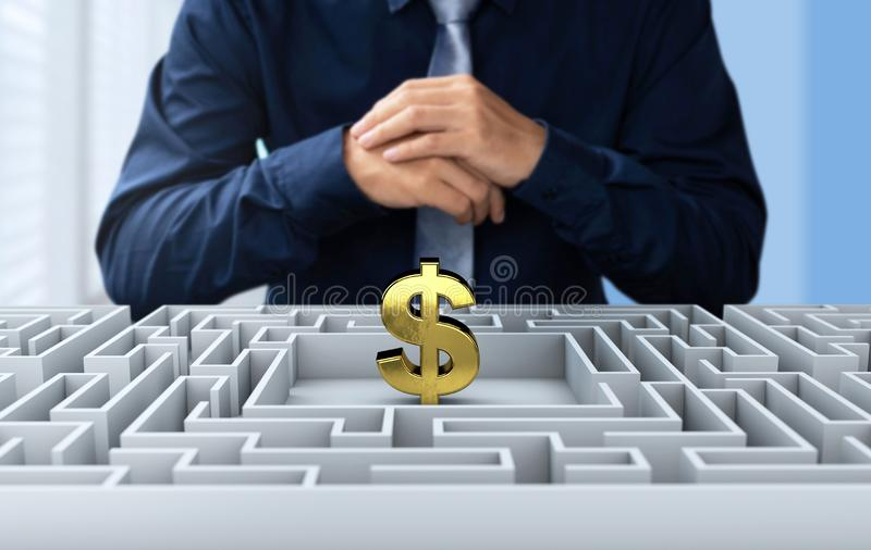 Businessman find the way to get money on maze stock photography
