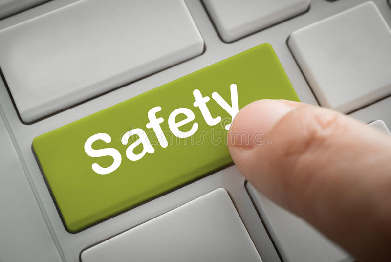 Businessman fingers press in safety button stock image