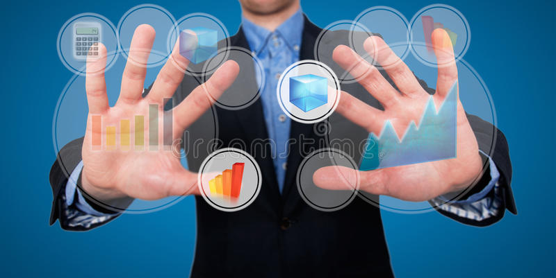 Businessman fingers are touching the space in front of him at visual touch screen - Stock Image. A businessman in front of a visual touch screen is illustrating royalty free stock images