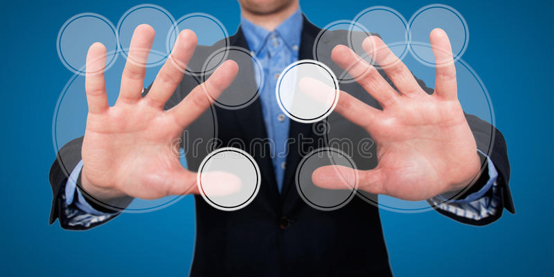 Businessman fingers are touching the space in front of him at visual touch screen - Stock Image. A businessman in front of a visual touch screen is illustrating royalty free stock photos