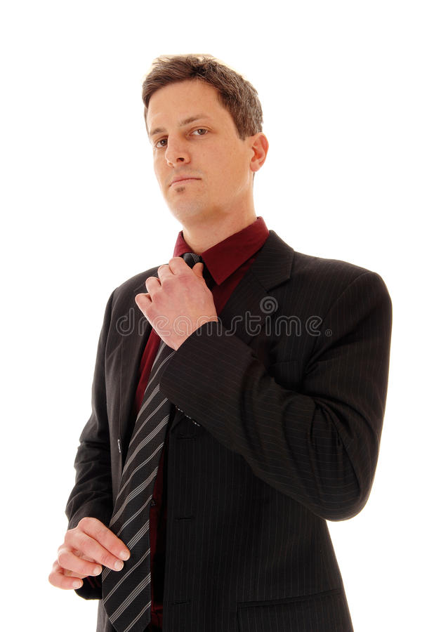 Businessman fixing his tie. royalty free stock photos
