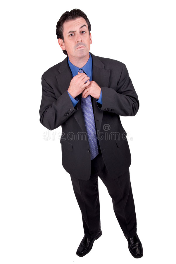 Businessman fixing tie royalty free stock photography