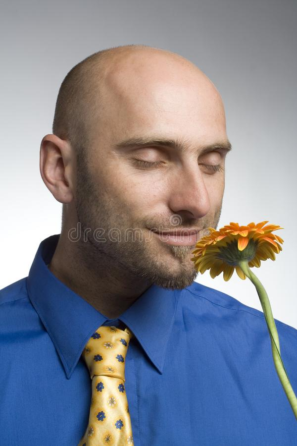 Businessman with flower royalty free stock photos