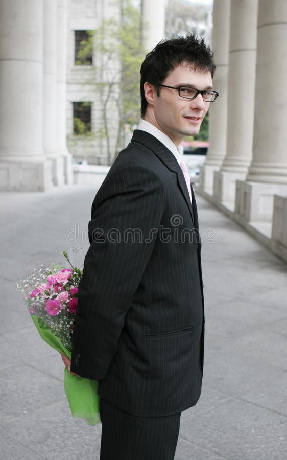 Businessman with flowers royalty free stock photos