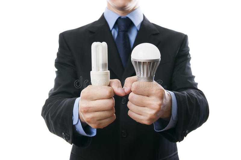 Businessman with fluorescent and LED lamps and incandescent royalty free stock images